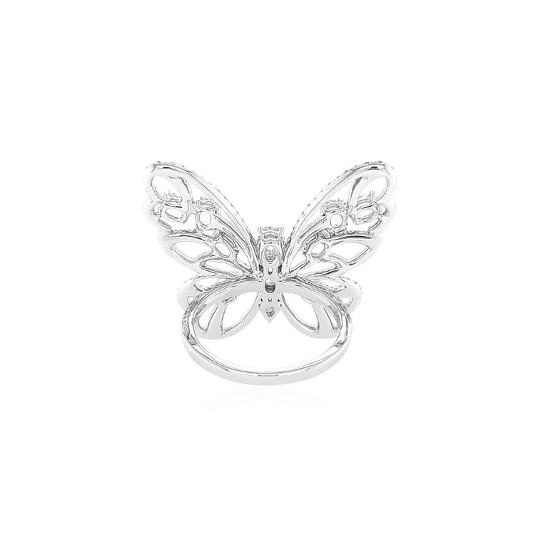 This mesmeric K18 White Gold cocktail ring features the exceptional natural Rose Cut White Diamonds at its forefront. The incredibly Rose Cut diamonds are perfectly accentuated by the diamond butterfly motif which surrounds them. Bold, yet