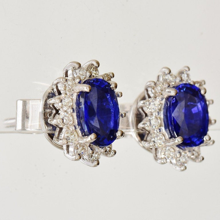 18 carat white gold earrings set with Sapphire and diamond.  The Sapphires were tested by the GFCO Gem Lab of Switzerland who find them to be natural Sapphires Royal Blue in colour.  An official grading of Royal Blue means these can be called Ceylon