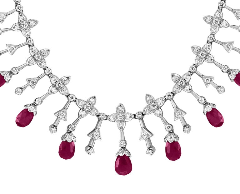 Ruby  Briolettes and Diamond Necklace in 18 Karat Gold  This spectacular Necklace  consisting of 13 Briolettes  of  Ruby approximately  18 Carats.  The  Ruby  is surrounded by approximately 10 Carats of  brilliant cut diamonds .  18 K gold 37