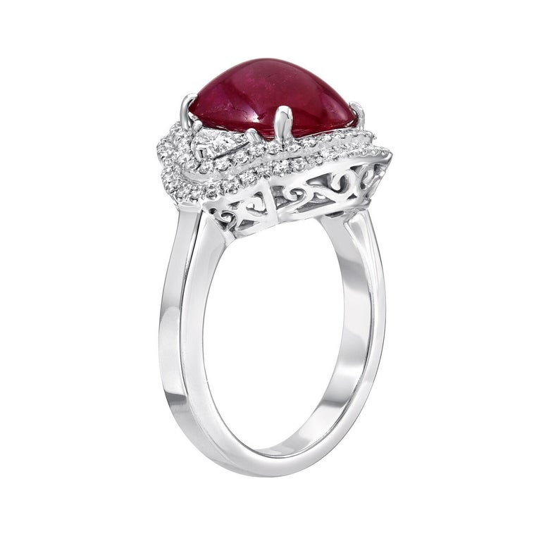 Natural Ruby ring featuring an unheated 5.00 carat cabochon, adorned by a total of 1.20 carat diamonds, creating this impressive 18K white gold cocktail ring.  Size 6. Resizing is complementary upon request. The GIA certificate is attached in the