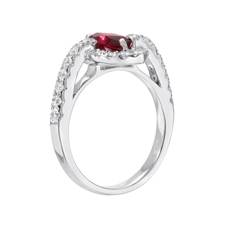 Natural Ruby unheated 1.01 carat marquise, set in a 0.55 carat total, round brilliant diamond and 18K white gold engagement ring or cocktail ring.  Ring size 6.5. Re-sizing is complimentary upon request.  The GIA certificate is attached to the