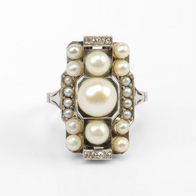 Created in France in the 1920s, this natural saltwater pearl and diamond ring is a geometric tour de force.  We've all seen Art Deco platinum and pearl rings. And we've all admired them. But have we ever seen one quite like this? Where the boxy