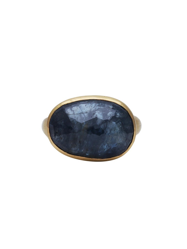 A beautiful ring with a 18.67 carats Natural Sapphire set in 22K Matte finish Gold. A simple and elegant ring.  Ring Size: US 7.5
