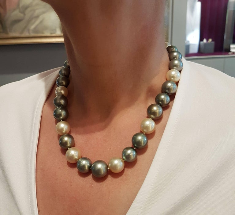 Adorable pearl necklace made of finely matched natural Tahiti and South Sea pearls 12,3 - 14,7 mm with an excellent luster. Natural colors beautifully matched, green, grey, vanilla, cream, brown. Unusual, elegant yet pure and simple.  Bajonet catch,