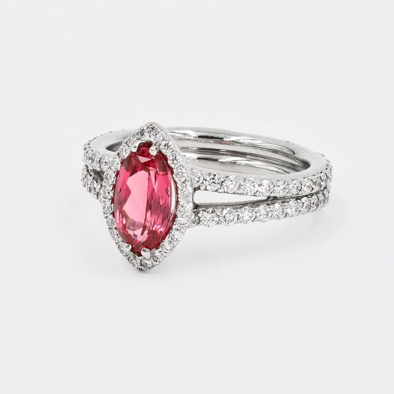 This elegant platinum ring contains a center 1.22cts. oval vivid pink spinel from Tanzania. Around the center and the entire shank are 110 ideal cut round diamonds=  1.12cts. t.w. (diamonds are G/VS)  Finger size is a 6, but can be sized to