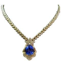 Natural Tanzanite Diamond 20.52 Carat and Solid Yellow Gold Diamond