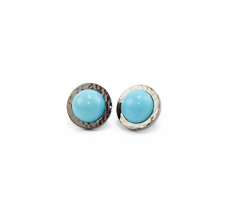 Nice earrings from our collection SOLE. Earrings realized in 18kt black gold and natural turquoise cabochon. Hammered design on the surfaces.  Pierce and post system.  Natural Turquoise ct. 10 Black Gold g. 5.5 Small gold circle diameter cm  1,7