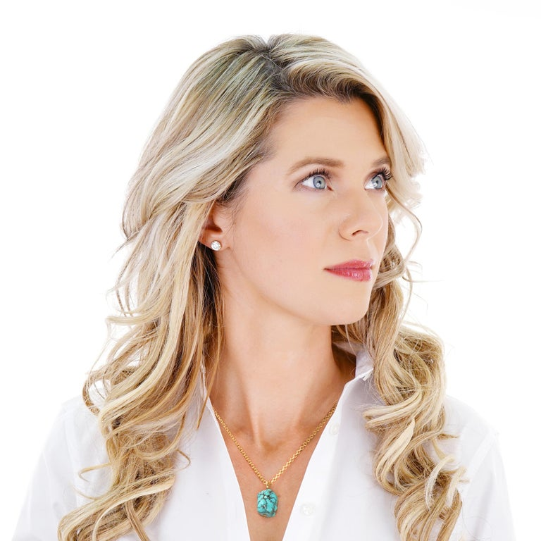 Circa 2000s, 18k, American.    In nature, there are only perfect shapes, color, and sounds. This pendant is a brilliantly hued natural piece of polished turquoise, elegantly set with an 18k gold ring. The look is effortless chic. Excellent