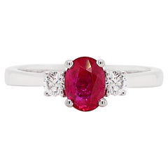Natural Unheated Oval Ruby and Diamond 18 Carat Gold Three-Stone Engagement Ring