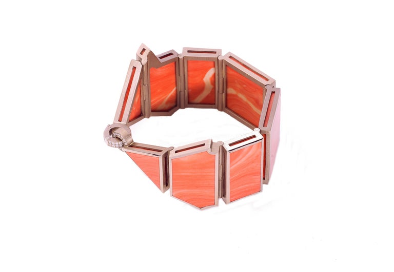 This stunning bracelet is made of white gold and one natural grown coral stem cut into 8 Pieces with a total weight of 69.80 grams. The clasp is decorated with Diamonds, fw/if, 0,47 carats. An exceptional piece of art and jewelry that can be worn as