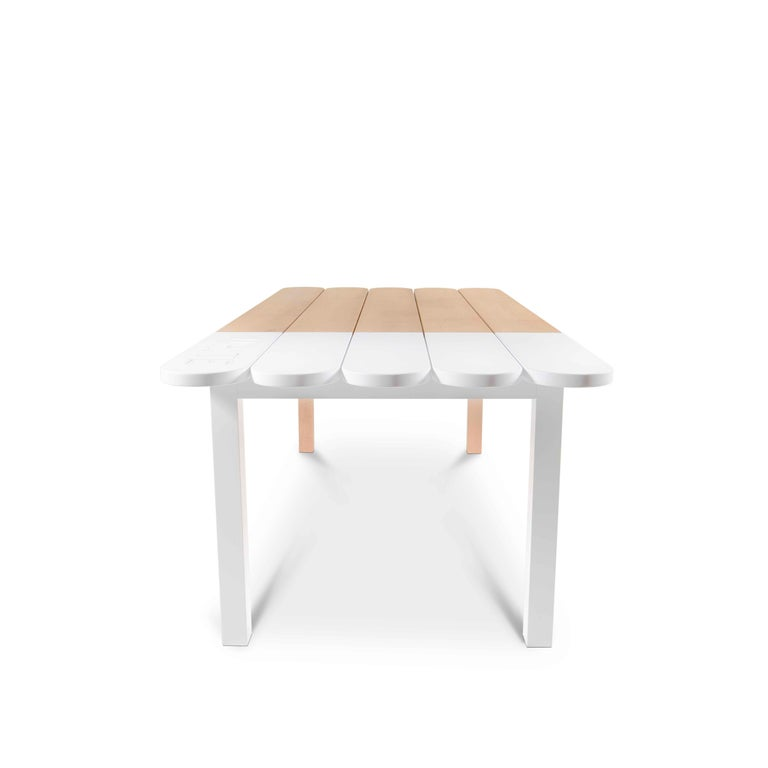 The Picolé dining table is inspired by the traditional ice cream sticks, present in any Brazilian beach and that follows a proposal of bare and Young Furniture for mixed indoor and outdoor areas. Made in Faia, a natural Portuguese wood, the Picolé