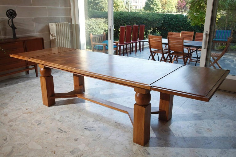 French Natural Wood Dining Table with 2 Extensions by Baptistin Spade For Sale