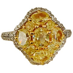 Natural Yellow Diamond and White Diamond Engagement Ring in 18 Karat Yellow Gold