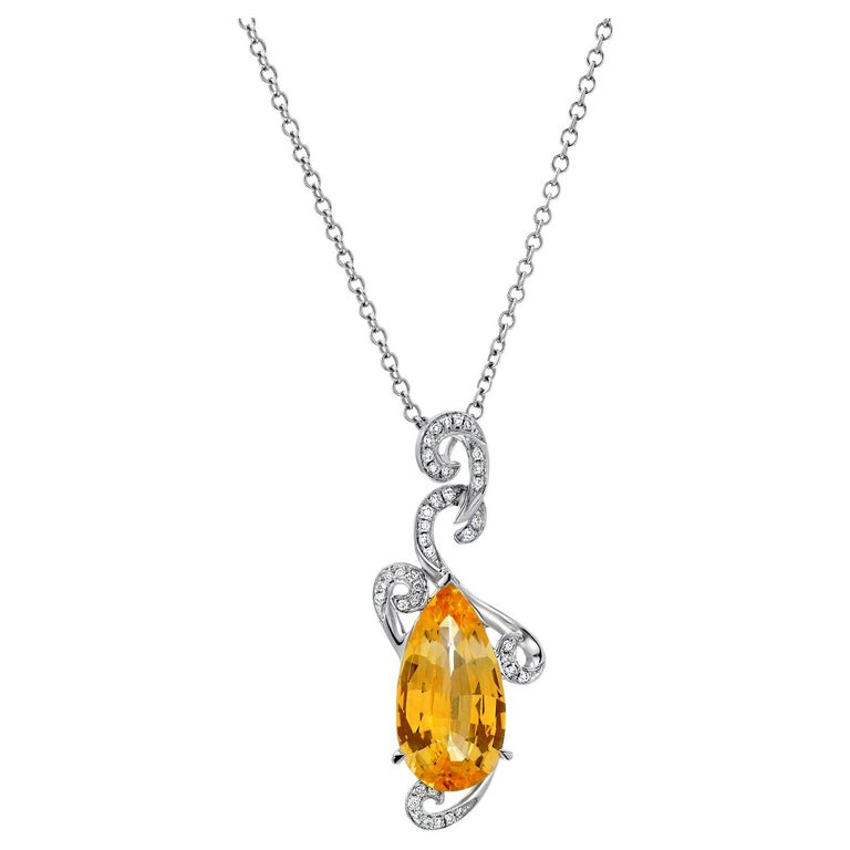 Natural, unheated 5.13 carat Ceylon Yellow Sapphire pear shape, and 0.21 carats total round brilliant diamonds, set in this modern 18K white gold diamond necklace. Chain length is 17 inches but it can be adjusted, complementary, upon request.  GRS