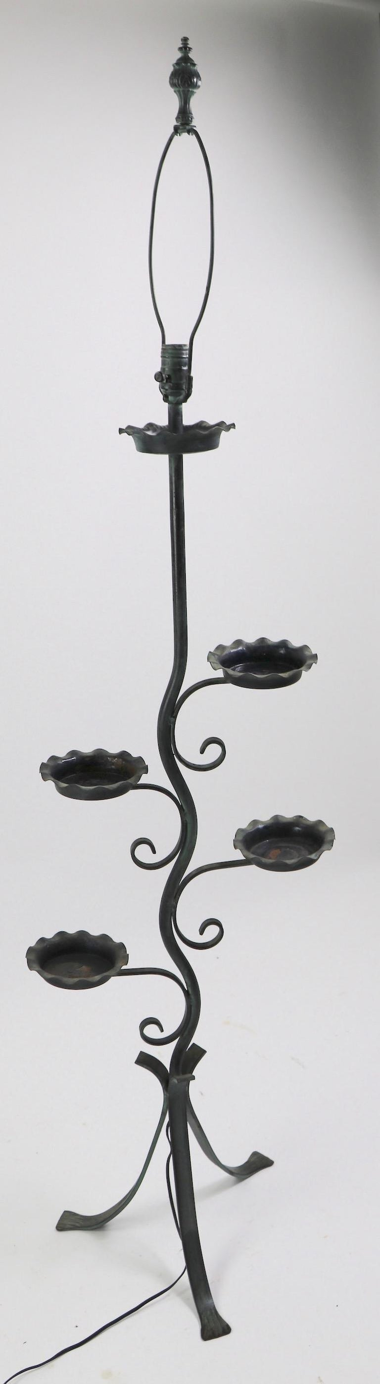 Stylish wrought and cast iron floor lamp, plant stand, in original faux verdigris finish. This interesting floor lamp has four arms, or branches, which support small ( 5.5 inch total diameter) trays, designed to hold a potted plant. The top is a