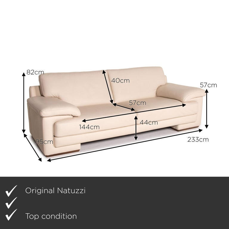 We present to you a Natuzzi 2198 leather sofa cream three-seater couch.    Product measurements in centimeters:    Depth: 95 Width: 233 Height: 82 Seat height: 44 Rest height: 57 Seat depth: 57 Seat width: 144 Back height: 40.