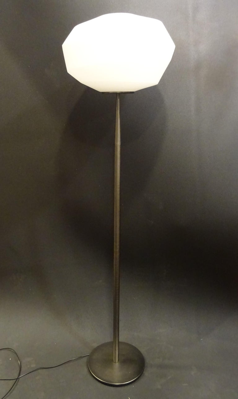 A timeless and at the same time trendy Italian Natuzzi floor lamp. In polished steel and mat white blown glass. multifaceted shade. In a perfect condition. Natuzzi started in the 1960s in Italy and now is one of the best Italian design houses