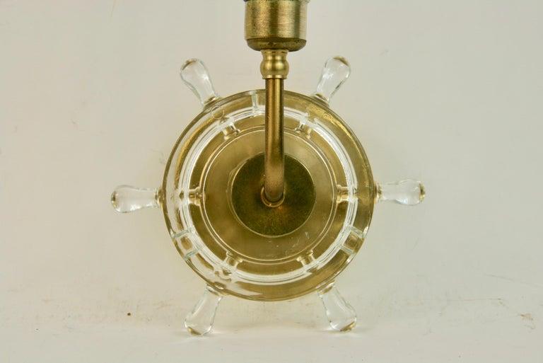 2-1834 pair of ships wheel nautical sconces Takes one 60 watt candelabra base bulb.