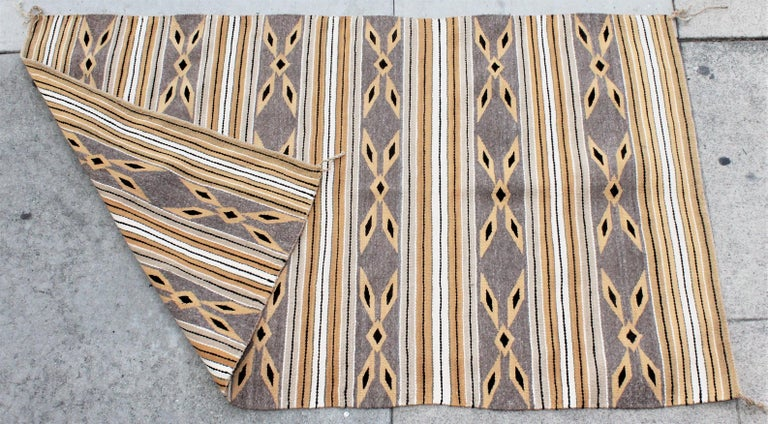 This fine golden rod and grey simple geometric weaving is in fine condition.