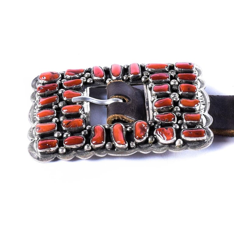 Excellent quality Navajo coral concho belt, with high grade coral conchos; marked sterling silver. Signed