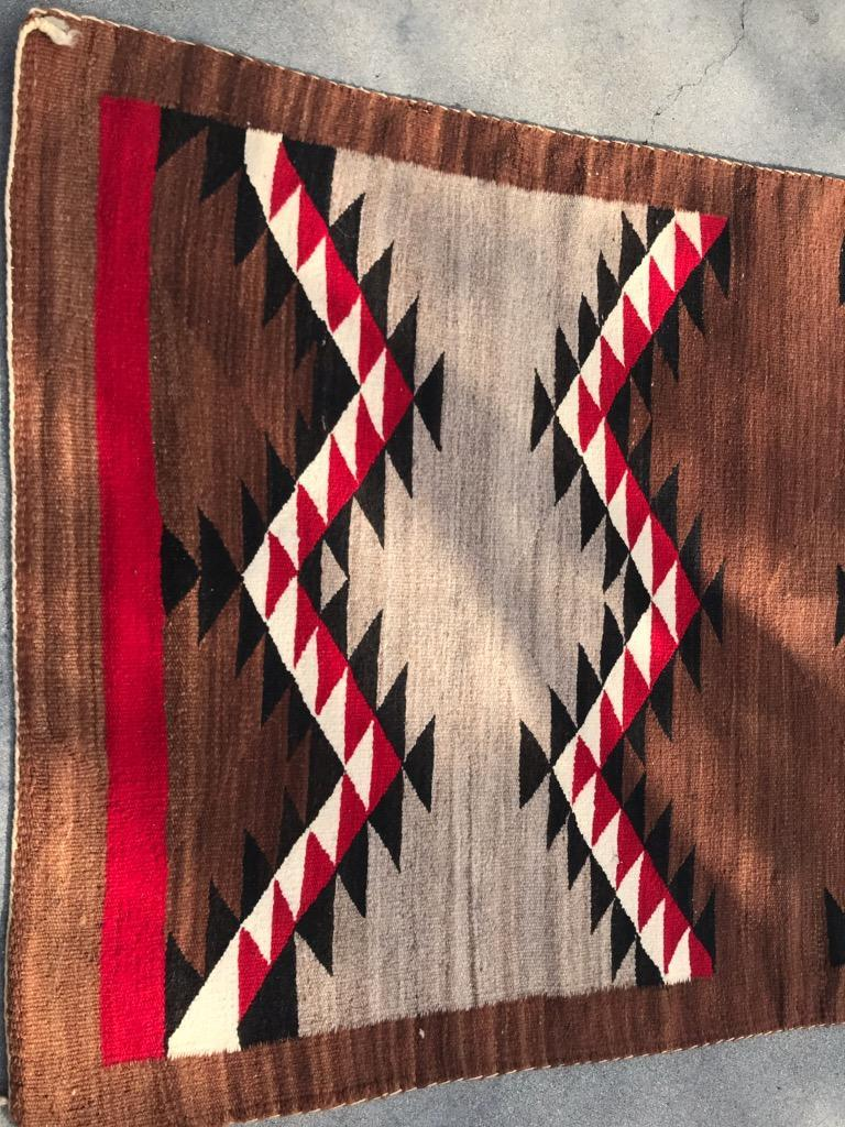 1940s Navajo eye dazzler weaving with flying geese pattern.