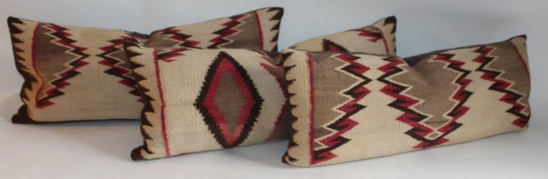 These very early saddle blanket weaving pillows are in good condition and have brown cotton linen backings. These Fine eye dazzler pillows are in such unusual colors. Sold as a group of three or 1195.00 each.