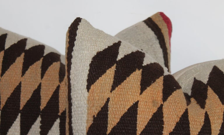 This fine pair of Navajo Indian weaving pillows are in fine condition and have cotton linen backings. Sold as a pair.