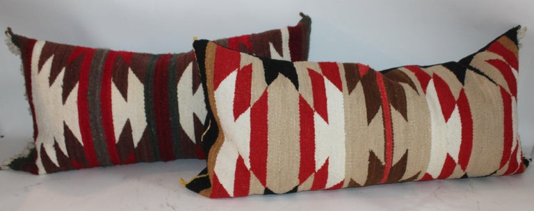 These three Navajo saddle blanket weaving pillows are in great condition and are sold as a collection of three. Sold individually they are $950. Each and as a group they are 2295. for the group. All three have cotton linen backings.  35 x 18