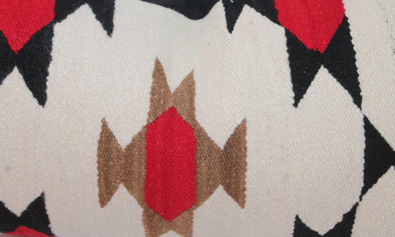 Early Navajo saddle blanket weaving bolster pillow in fine condition. This nice geometric design is unusual and the bolster has a black cotton linen backing.