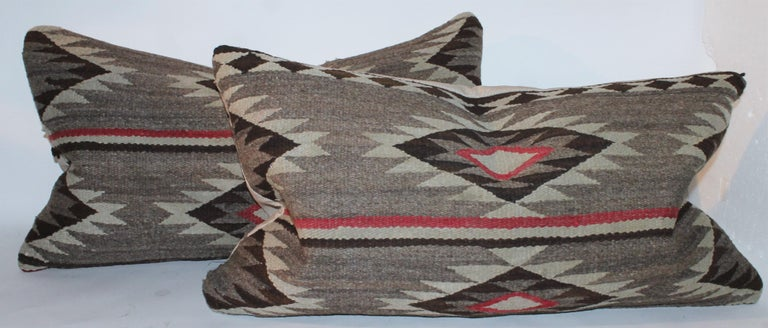 These large Navajo Indian weaving eye dazzler bolster pillows are in fine condition. Sold individually.