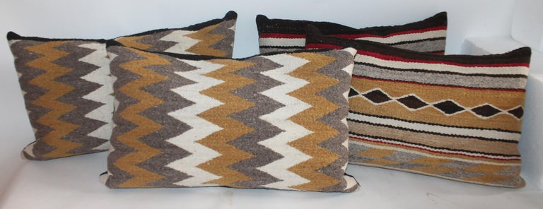These fine Navajo Indian weaving pillows are being sold in a group of four pillows. One pair is streak of lighting pattern and second pair is diamond bars. Both pairs are normally 995.00 a pair. Special deal is for both pairs.