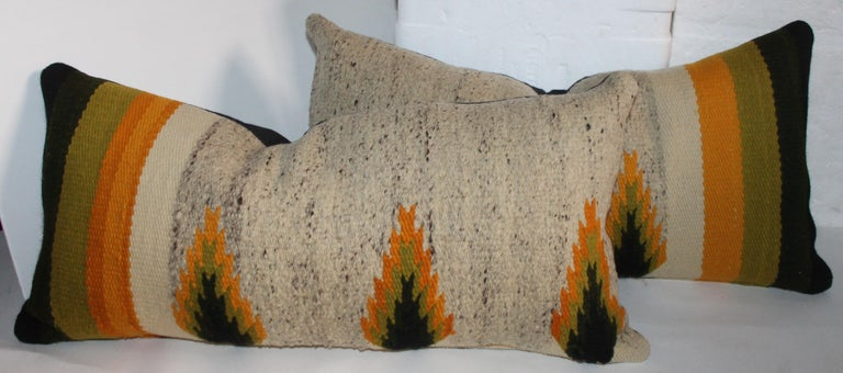 Navajo Indian weaving bolster pillows sold in pairs. There are two pairs of these weaving pillows. The colors are like Indian sunset.