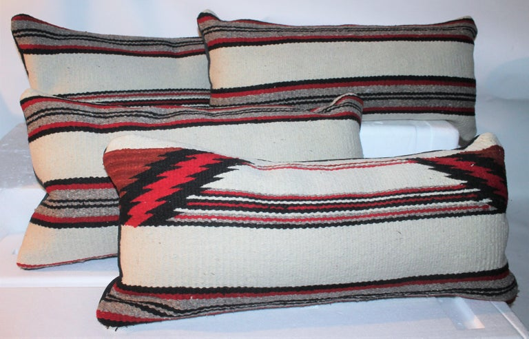 These fine saddle blanket Indian weaving bolster pillows have black suede / leather backings. The condition are very fine. Sold in pairs.