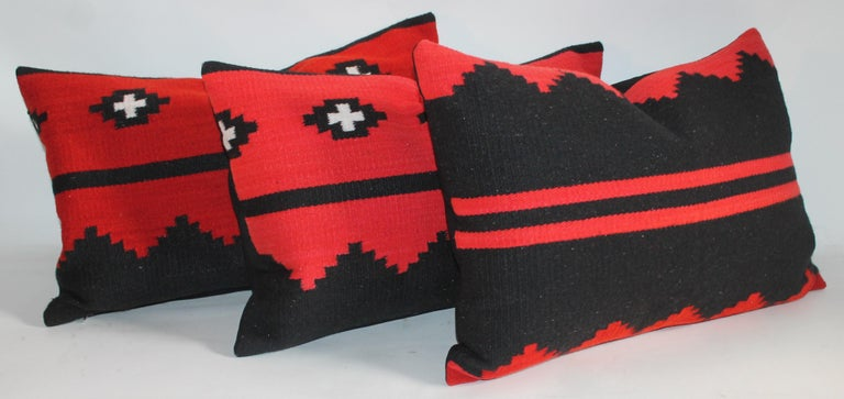 These three Navajo Indian weaving bolster pillows are from a saddle blanket. Selling as a group of three or $875. each. The condition are very good with black cotton linen backings.