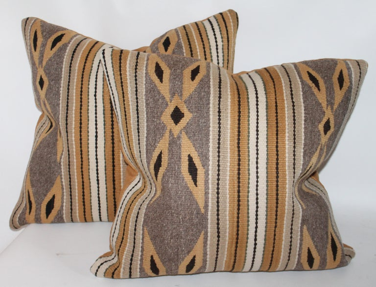 These fine Navajo Indian weaving pillows are sold as pairs. There are two pairs in stock. They are in fantastic condition.