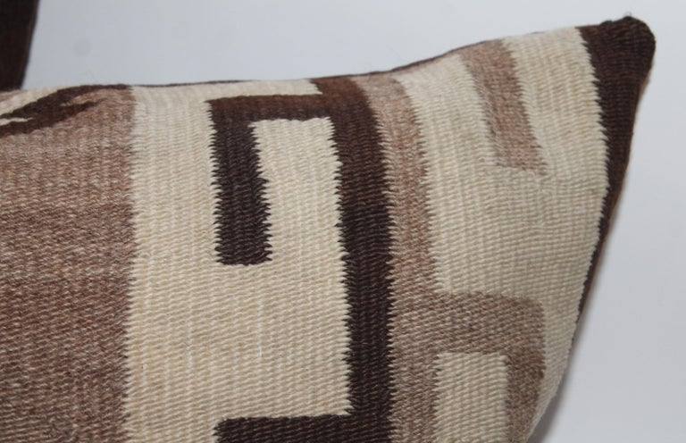 Navajo Indian weaving bolster pillow with brown cotton backing. This diamond pattern weaving pillow is in fine condition and is oversized.