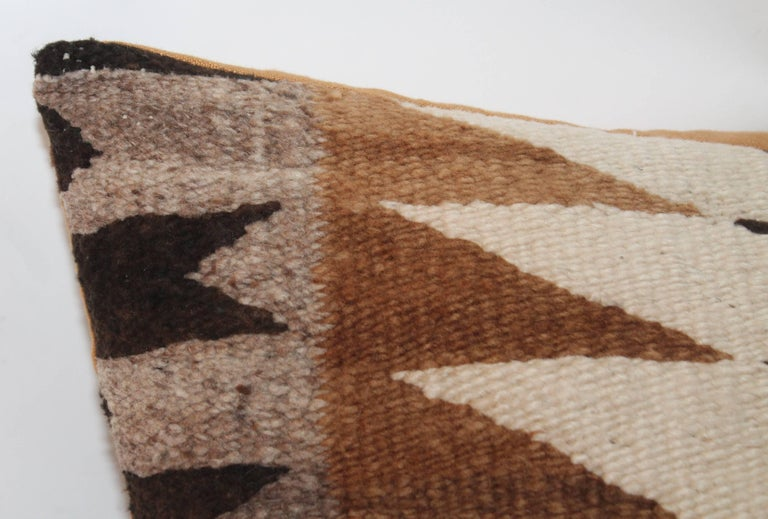 This Navajo Indian weaving bolster pillow is super early and fine condition. The backing is in a camel cotton linen.