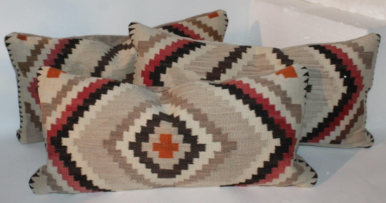 These eye dazzler pillows are interesting eye dazzler pillows. The backings are in suede / leather. The patterns are similar in each pillow.