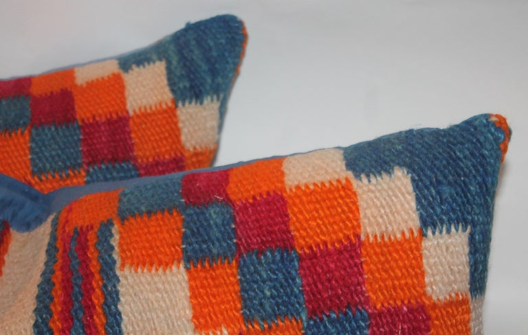 This fine pair of colorful Navajo Indian weaving saddle blanket pillows have blue linen backings. Sold as a pair.