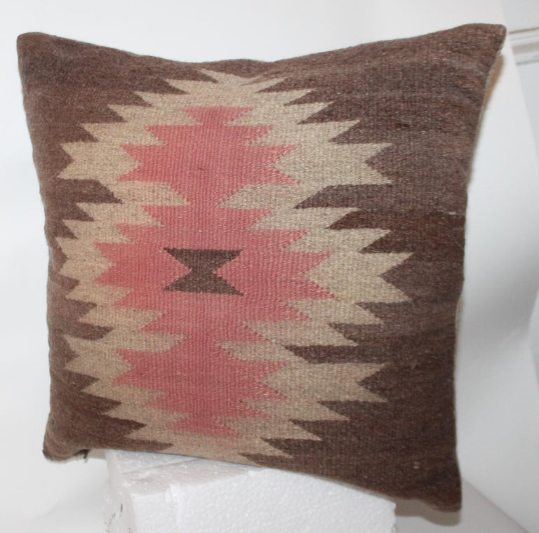 This is such unusual colors and fine weaving with such somber colors. The backing is in a thick homespun linen.