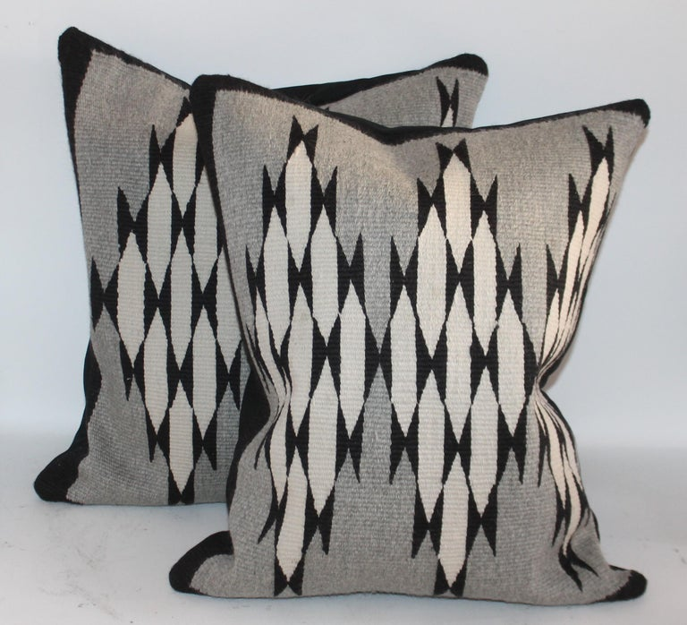 These black and white with a grey ground are so unusual for Navajo weaving's. These pillows have a black cotton linen backing. The condition are pristine. Sold as a pair.