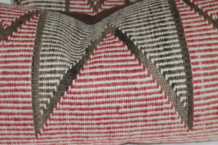 These Navajo Indian weaving pillows are in fine condition and sold as a pair. The backings are in cotton linen.