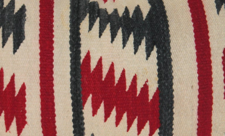 This large saddle blanket bolster pillow is in great as found condition. The backing is in black cotton linen.