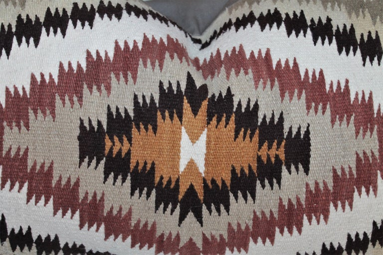 Navajo Indian saddle blanket weaving pillows in browns and geometric patterns. These two different pillows are in great condition and have tan cotton linen backings.  Measures: 37 x 18 larger pillow 37 x 17 smaller pillow.