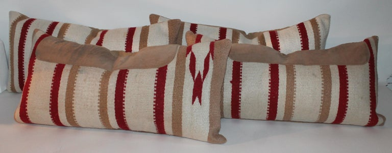 Navajo Indian weaving bolster pillows from a saddle blanket. Two pillows have suede on them and two are without. Two pairs in stock. Two pairs for 1895, for all four.