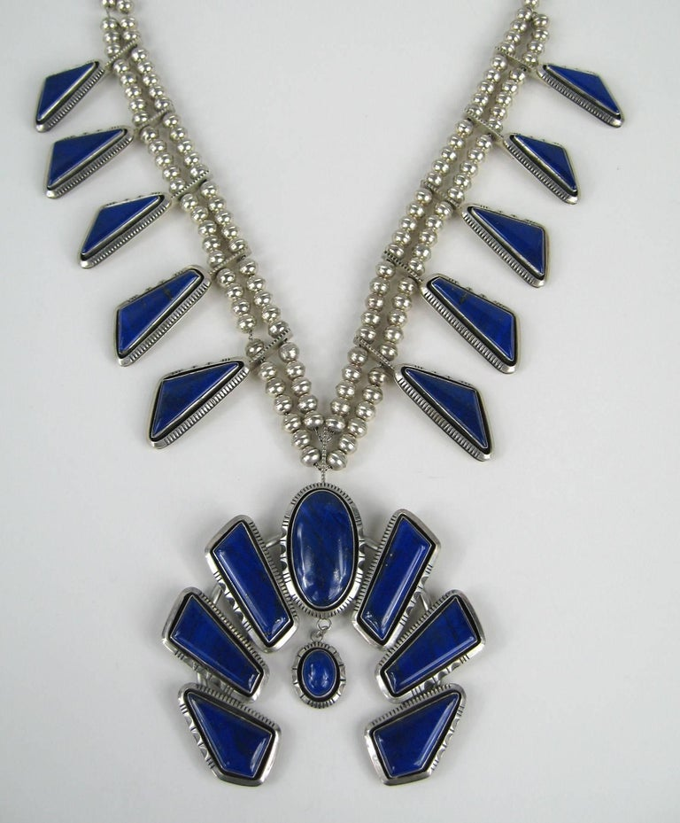 This is a Fabulous Lapis Lazuli Navajo Squash Blossom- This is a large necklace.  Hallmarked on the back Measuring. The Naja (center drop) is 3.90 inches x 3.73 top to bottom. Double beaded Sterling necklace is 23 inches end to end and Drops down to