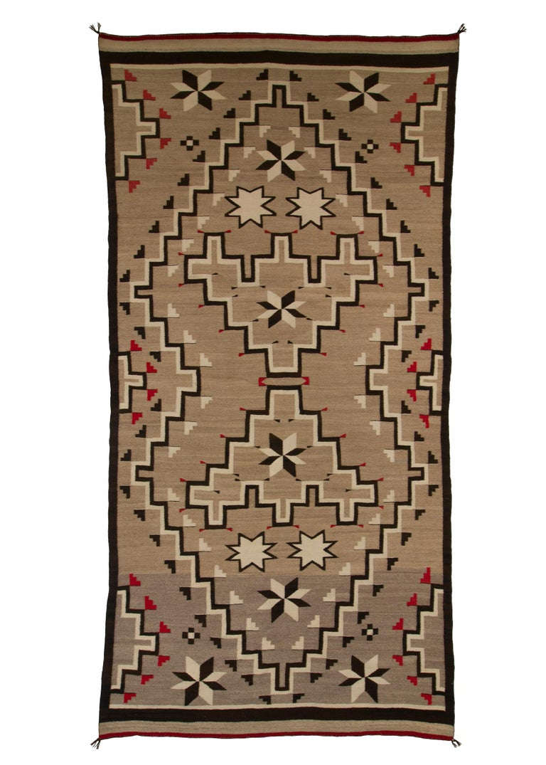 Navajo rug from the Trading Post Era, handwoven textile created in the 1920s-1940s, circa 1935. Woven of native hand-spun wool in natural fleece colors of gray/brown/tan with a geometric pattern in white/ivory, black/brown and red (dyed with