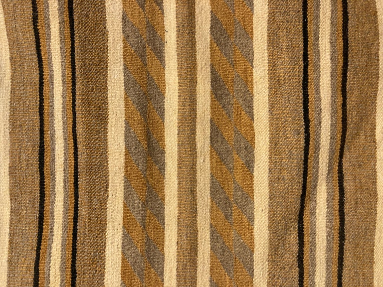 Unusual vintage Navajo rug, done in ivory, gold, un-dyed grey and dark brown wool, has a serene, contemporary look.