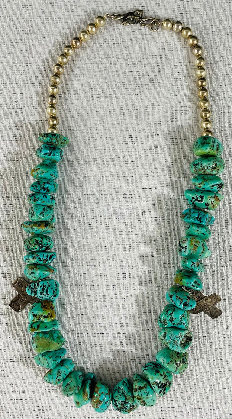 A vintage Native American Navajo turquoise stone necklace with authentic 26 pearls and two carved cross pendants in sterling silver. The necklace is attributed to the Jewelry designer T-Foree.  This vintage necklace will make a statement and is a