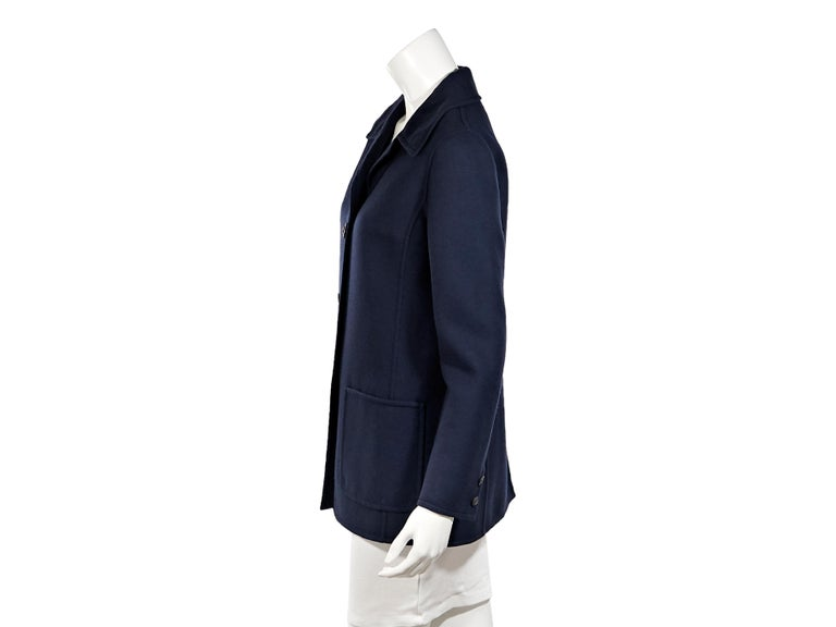 Product details:  Vintage navy blue wool coat by Hermes.  Spread collar.  Long sleeves.  Button-front closure.  Waist patch pockets.  Label size FR 44.  34